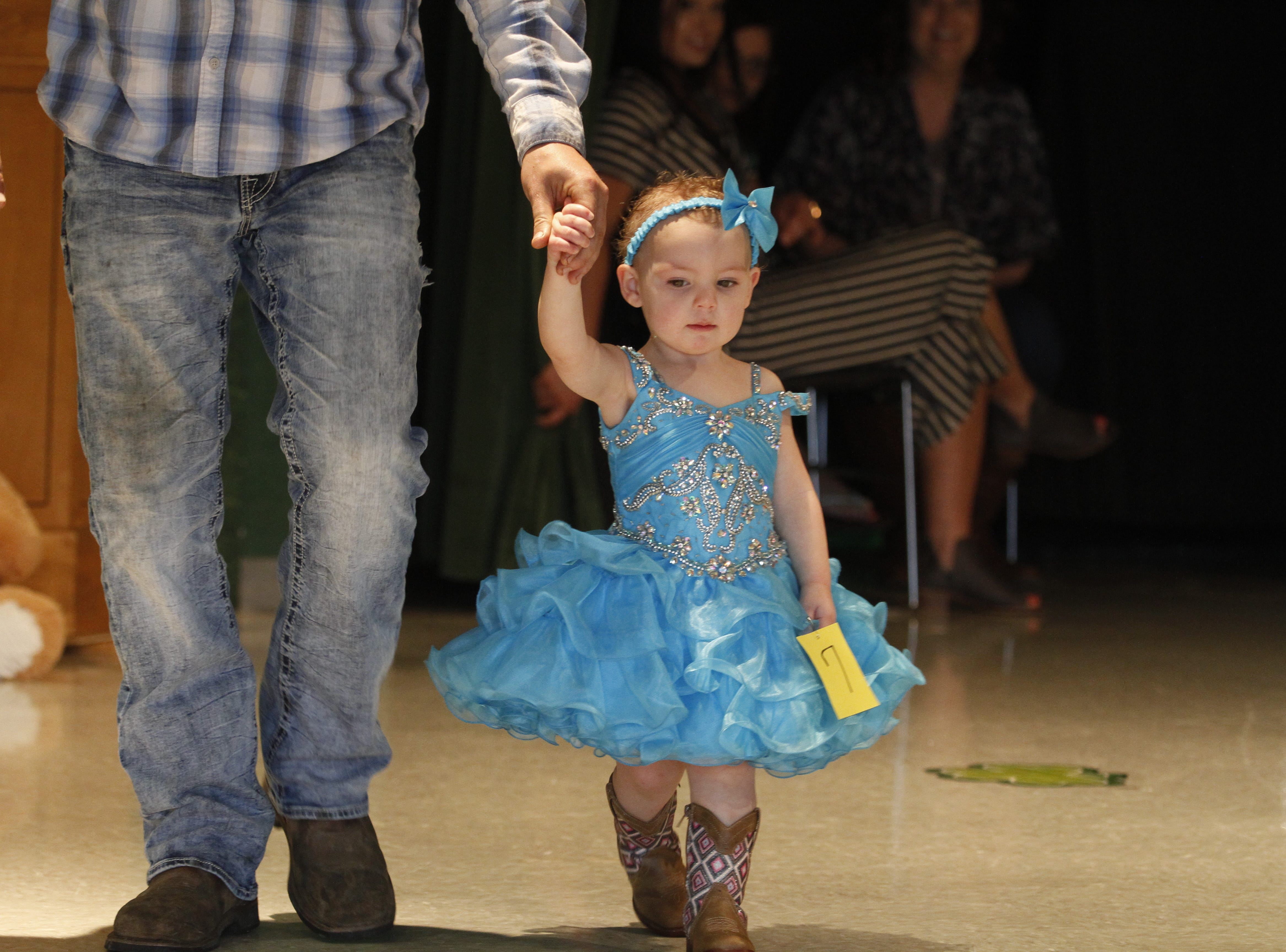 Aubree Richardson is escorted by Taylor Richardson as she competes in the Houston County Tiny Princess 1-year-old group during the 2019 Houston County Tiny Prince, Tiny Princess Pageant at Houston County High School, on Saturday, March 2, 2019 in Erin, Tenn.