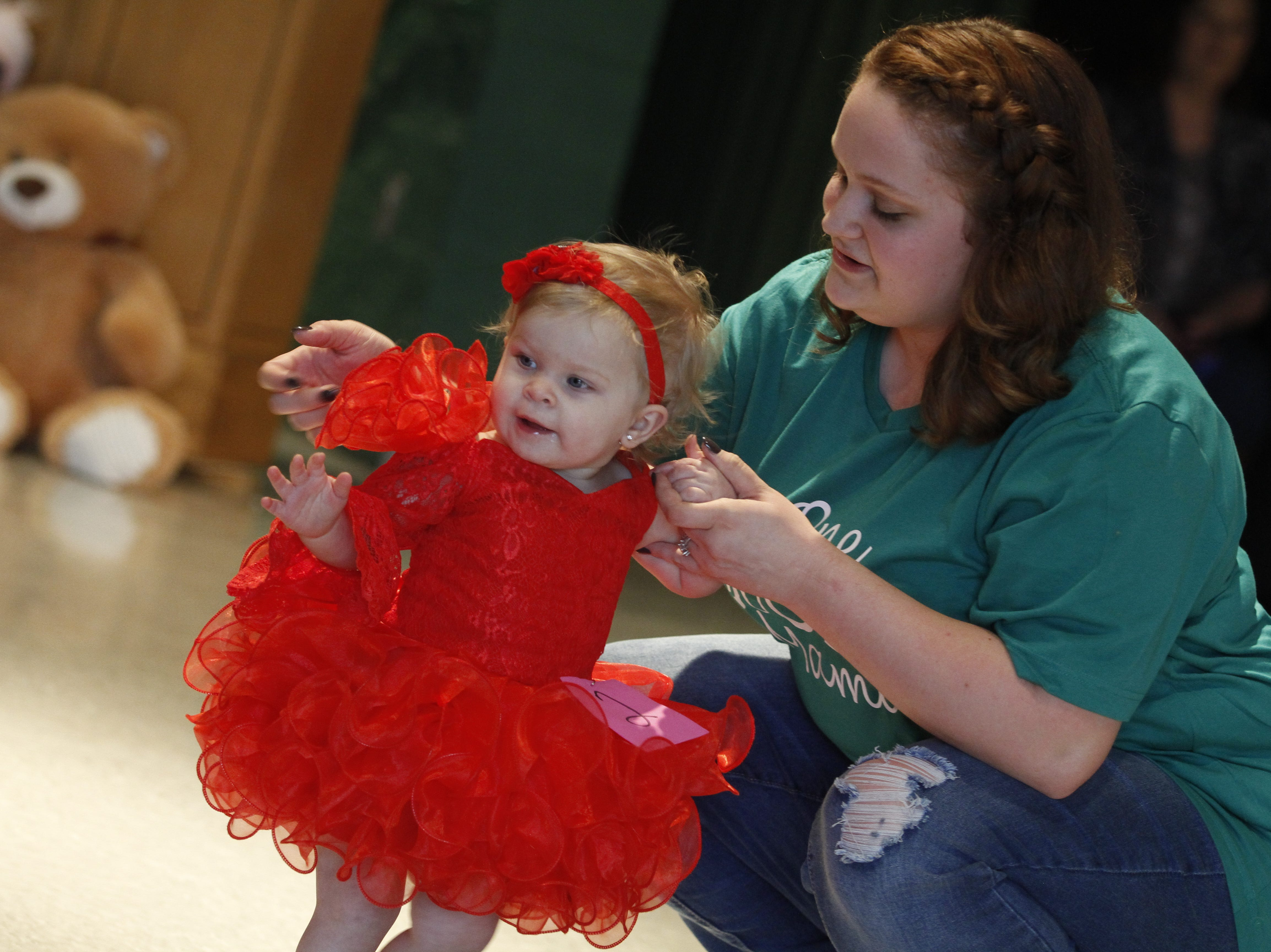 Avalynn Mohon competes at Saturday's Houston County Tiny Princess pageant with help from her mother Kassidy Mohon during the 2019 Houston County Tiny Prince, Tiny Princess Pageant at Houston County High School, on Saturday, March 2, 2019 in Erin, Tenn.