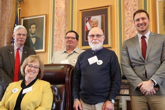 Marcia Hendricks of Winterset, Arlan Blazek of Greenfield, Robert Waldron of Winterset met with state Rep. Stan Gustafson and state Rep. Ray Sorenen during Hospital Day on the Hill.