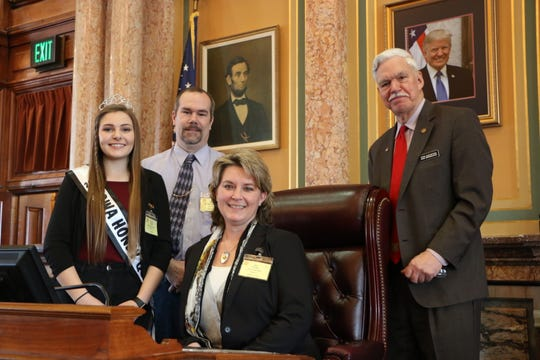 Iowa Honey Queen Brooklyn Pardall of West Point, Eric Kenoyer and Keri Kenoyer of Van Meter, representing the  Honey Producers Association, met with state Rep. Stan Gustafson.
