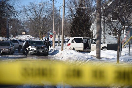 Des Moines police investigate a shooting in the 1300 block of 18th Street on Sunday, March 3, 3019.