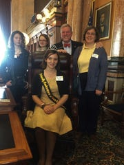 The Friendly Beekeepers of Iowa Queen, Emma Jakes of Indianola, stopped by the Capitol during Iowa Honey Bee Day with her mother Amy, sister Katie, and Melody Reeves from Ackworth.