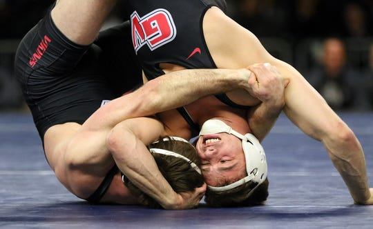 At 149 lbs, Grand View's Josh Wenger, right, pins his teammate Devin Reynolds to place first. NAIA Wrestling National Championships in Des Moines.