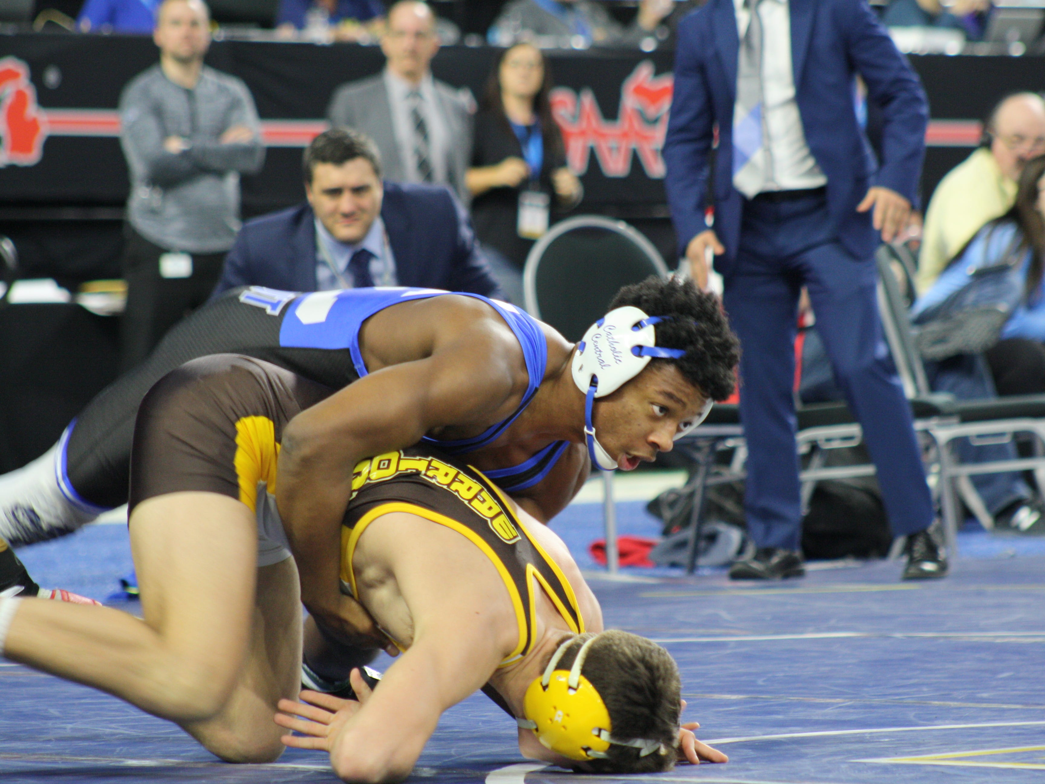 Kevon Davenport of Novi Detroit Catholic Central gets the edge on Vic Schoenherr of Bay City Western in Saturday's finals at Ford Field.