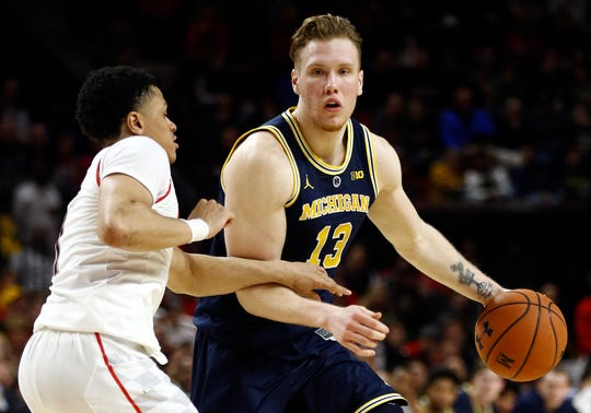 Michigan's Ignas Brazdeikis drives against Maryland guard Anthony Cowan Jr. in the first half on Sunday in College Park, Md.