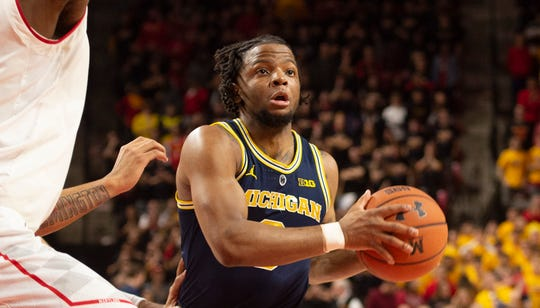 Michigan guard Zavier Simpson looks to pass as Maryland forward Bruno Fernando defends during the first half on Sunday, March 3, 2019, in College Park, Md.