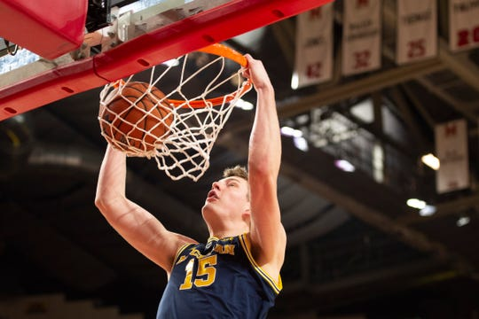 Michigan center Jon Teske dunks during the first half against Maryland, March 3, 2019 in College Park, Md.