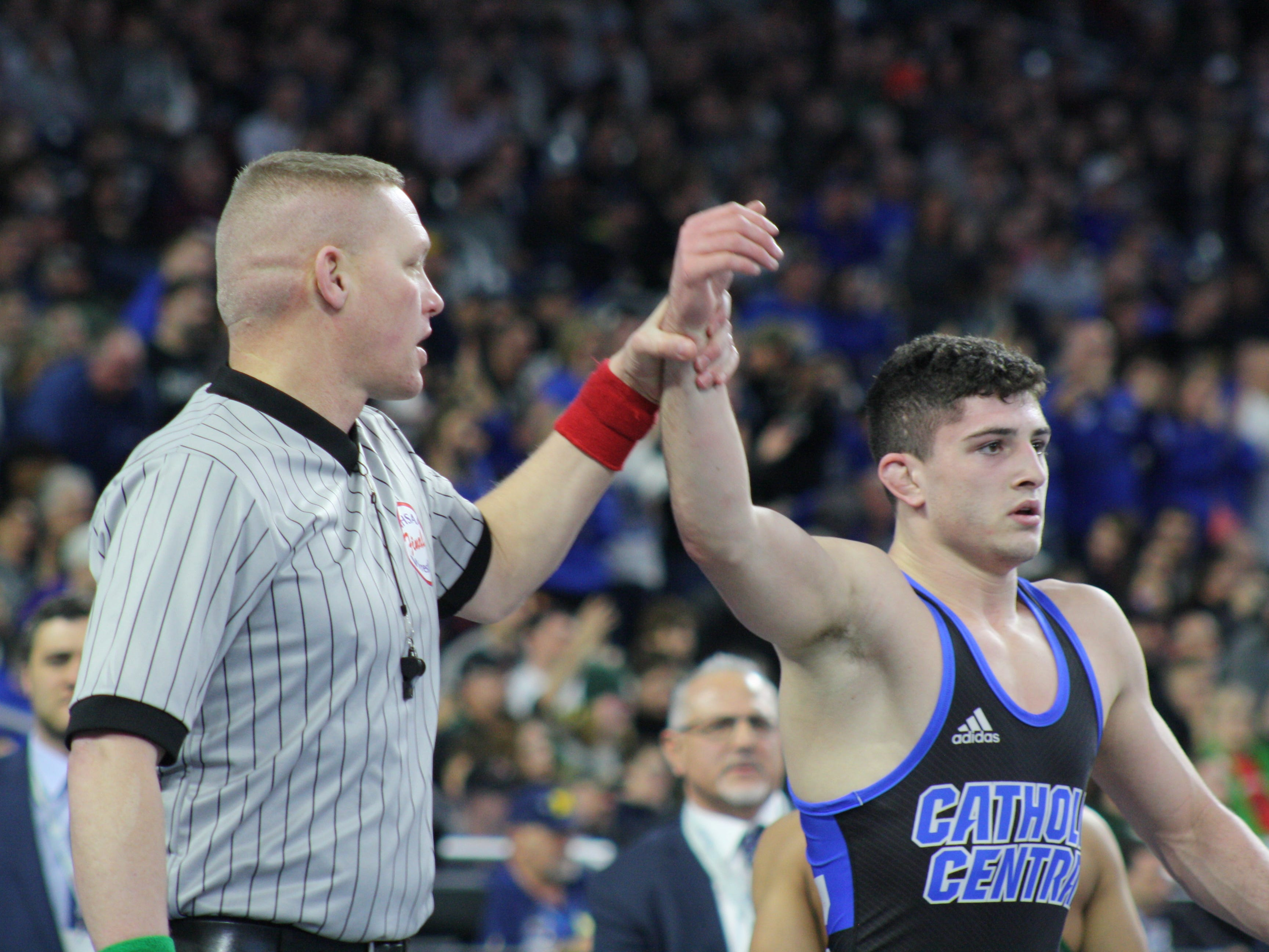 Novi Detroit Catholic Central's Cameron Amine wins his third title in four years by taking down Jaden Fisher of Lake Orion, 11-3.