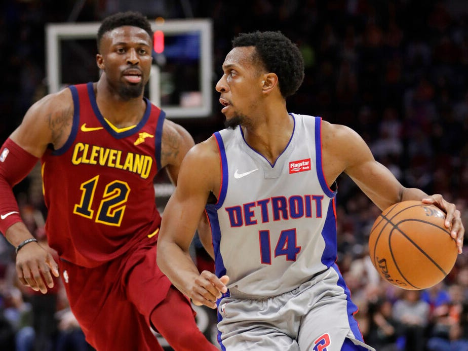 Detroit Pistons' Ish Smith (14) drives past Cleveland Cavaliers' David Nwaba (12) in the first half.