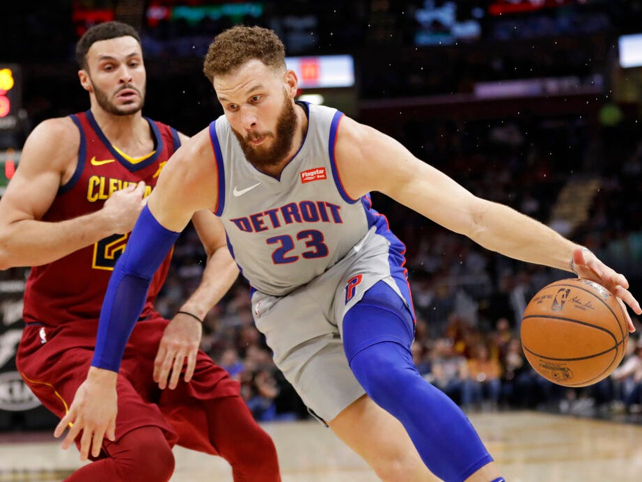 Detroit Pistons' Blake Griffin (23) drives past Cleveland Cavaliers' Larry Nance Jr. (22) in the first half. Detroit won the game 129 to 93.