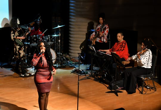 Princess Covergirl Taylor performs with the All Woman Band at the Women in Hip Hop event at the Charles H. Wright Museum of African American History in Detroit, March 3, 2019.  Band members are, from left, Sarah Rez on guitar, Aisha Ellis on drums, Emily Rogers on bass, Pamela Wise Harrison on keys and Ashley Nelson on violin.