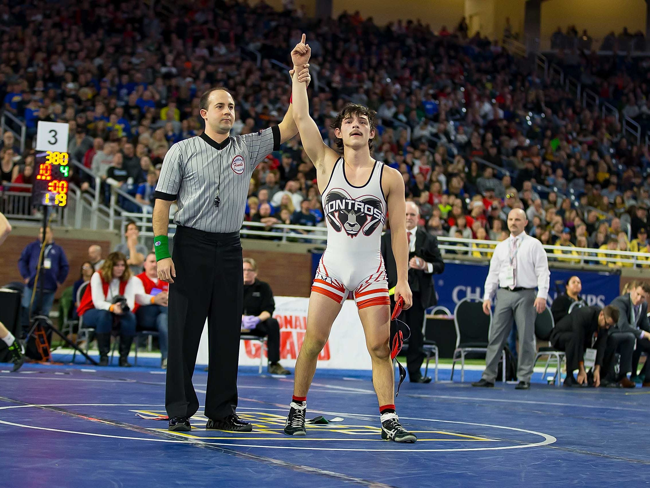 Jake Elasivich of Montrose raises his arm in victory after he defeated Brendan Connelly of Yale during their 119-pound Division 3 championship match.