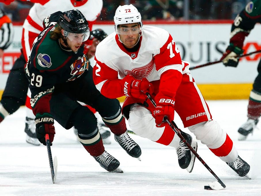 Detroit Red Wings center Andreas Athanasiou (72) skates with the puck in front of Arizona Coyotes right wing Mario Kempe (29) during the first period of an NHL hockey game Saturday, March 2, 2019, in Glendale, Ariz.