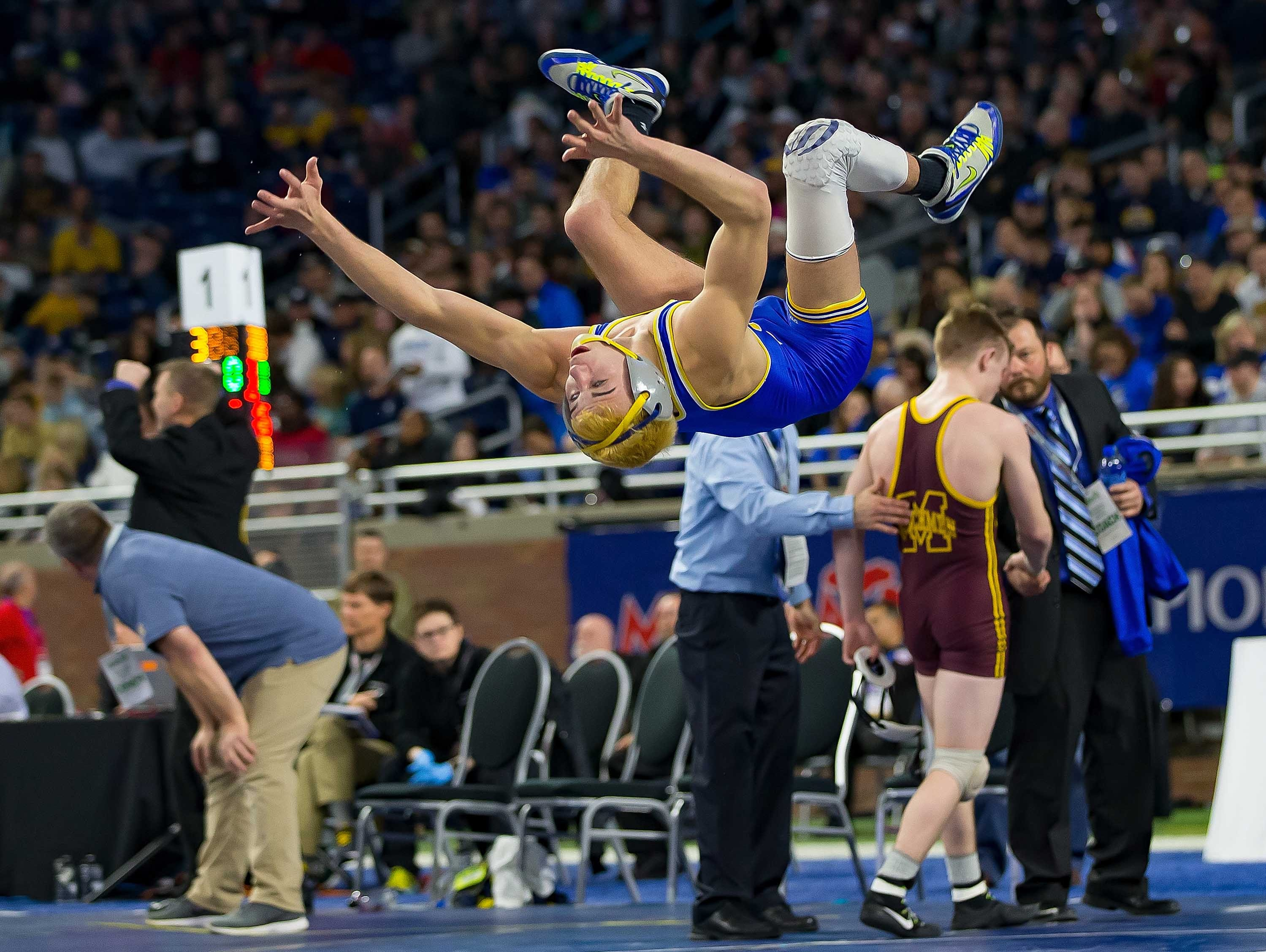 Jamison Ward of Carson City-Crystal does a back-flip after defeating Jacob Shelby of Manchester during their 130-pound Division 4 championship match.