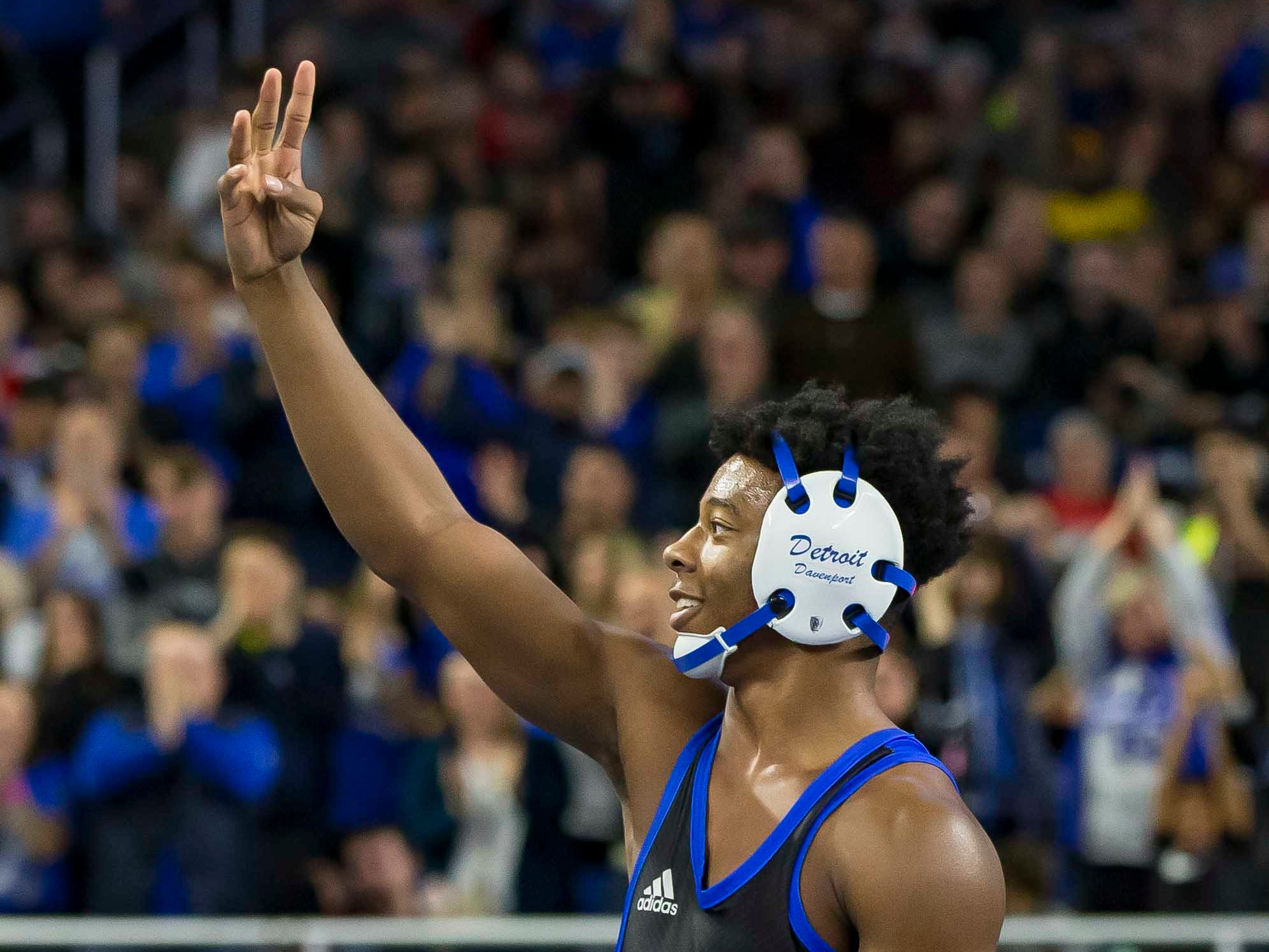 Kevon Davenport of Detroit Catholic Central flashes four fingers to the crowd after defeating Vic Schoenherr of Bay City Western in their 145-pound Division 1 championship match during the MHSAA Individual Wrestling Finals-Day 2 at Ford Field on March 2, 2019 in Detroit, Michigan. This was Davenports 4th straight state championship.