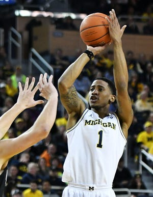 Michigan guard Charles Matthews (1) missed Sunday's game against Maryland with an ankle injury.