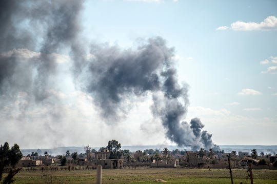 Smoke billows after shelling on the Islamic State (IS) group's last holdout of Baghouz, in the eastern Syrian Deir Ezzor province on March 3, 2019.