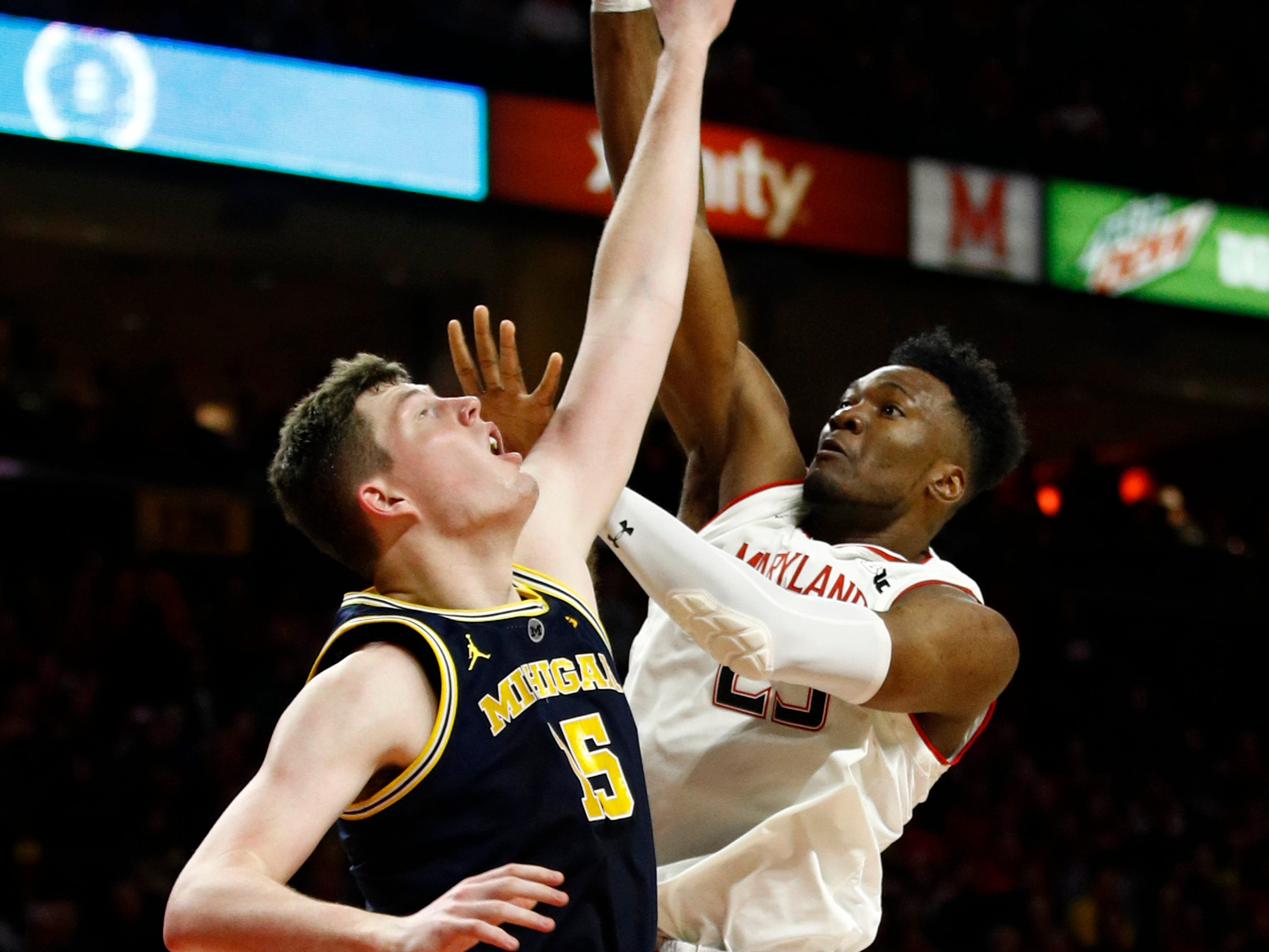 Maryland forward Bruno Fernando, right, of Angola, shoots over Michigan center Jon Teske in the second half.