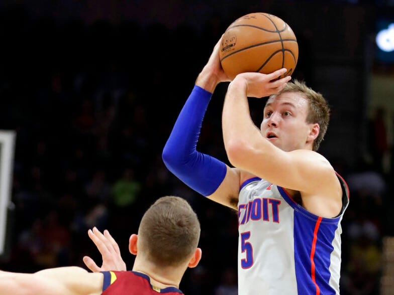 Detroit Pistons' Luke Kennard, right, shoots over Cleveland Cavaliers' Nik Stauskas in the first half of an NBA basketball game, Saturday, March 2, 2019, in Cleveland.