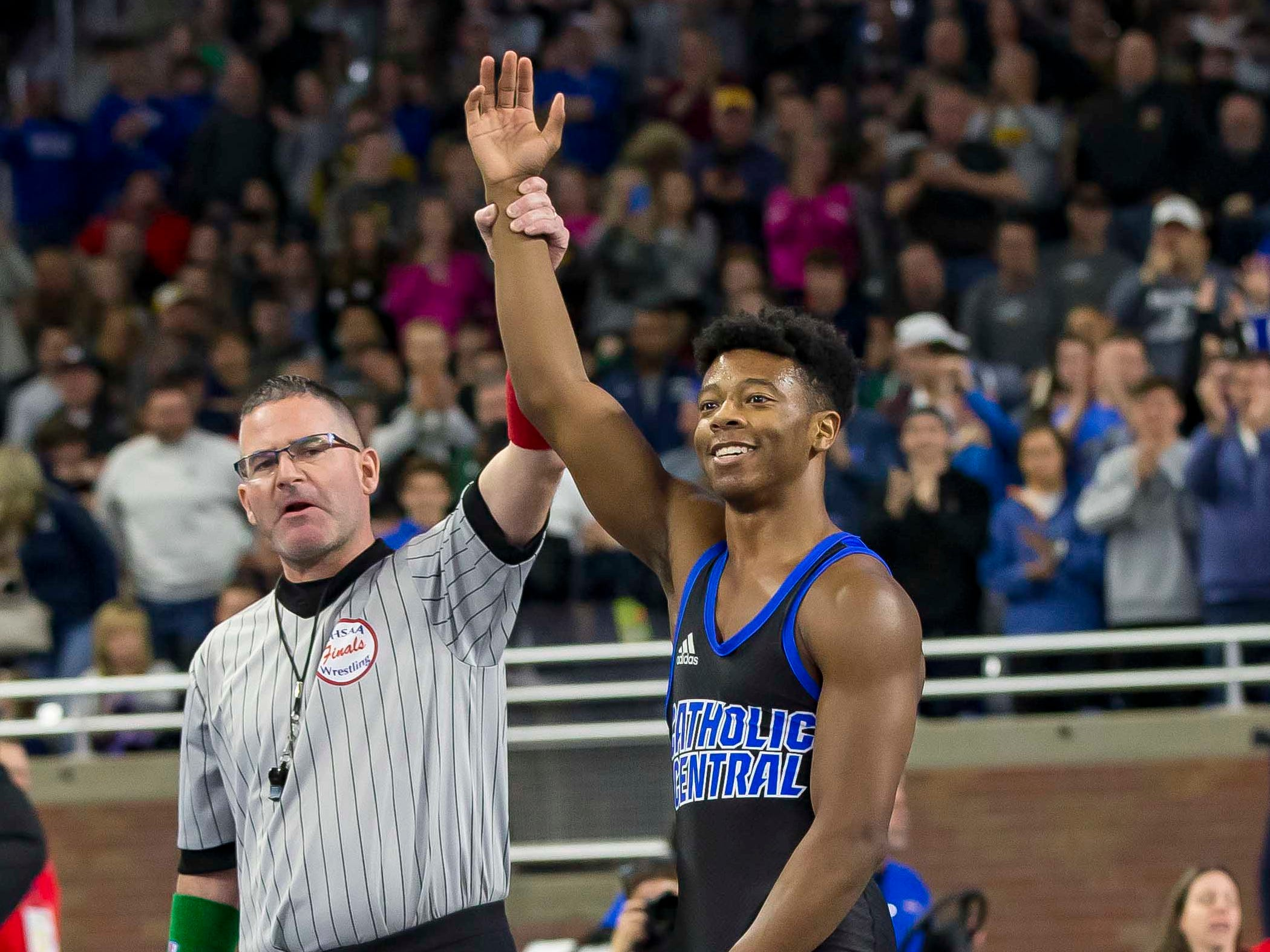 Kevon Davenport of Detroit Catholic Central has his arm raised in victory after defeating Vic Schoenherr of Bay City Western during their 145-pound Division 1 championship match during the MHSAA Individual Wrestling Finals-Day 2 at Ford Field on March 2, 2019 in Detroit, Michigan. This was Davenports 4th straight state championship.