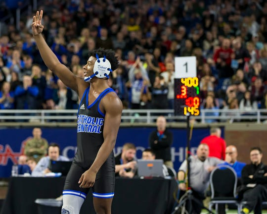 Kevon Davenport of Detroit Catholic Central celebrates his fourth state championship Saturday at Ford Field.