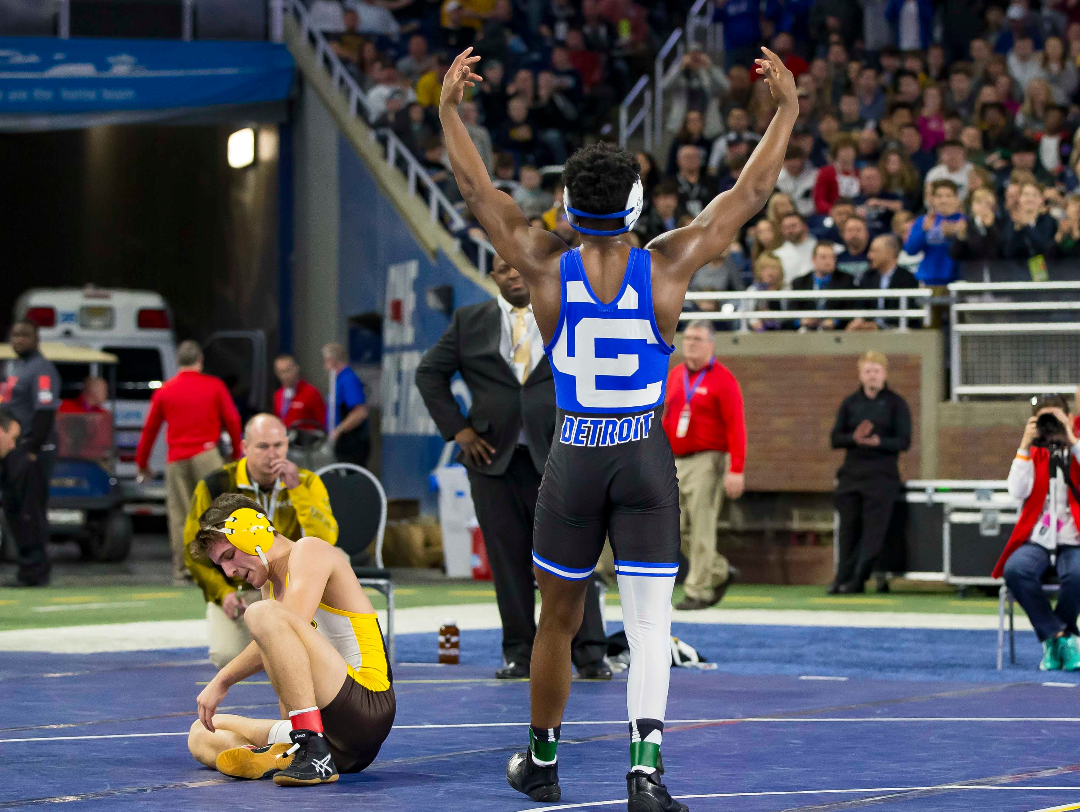 Kevon Davenport of Detroit Catholic Central plays to the crowd after defeating  Vic Schoenherr of Bay City Western during their 145-pound Division 1 championship match. This was Davenports 4th straight state championship.