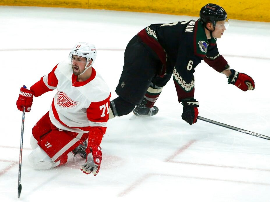Detroit Red Wings center Dylan Larkin (71) complains to a referee after thinking he was tripped by Arizona Coyotes defenseman Jakob Chychrun (6) during the third period.