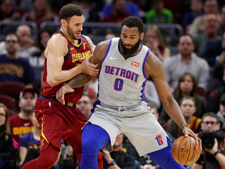 Detroit Pistons' Andre Drummond (0) drives past Cleveland Cavaliers' Larry Nance Jr. (22) in the first half of an NBA basketball game, Saturday, March 2, 2019, in Cleveland.
