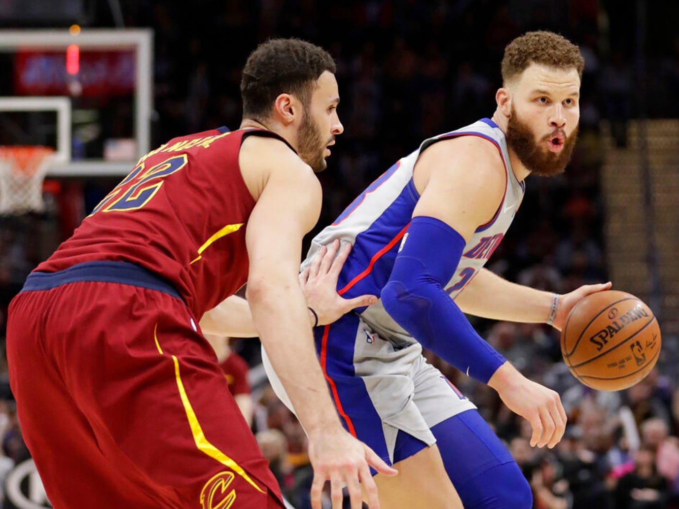 Detroit Pistons' Blake Griffin, right, drives past Cleveland Cavaliers' Larry Nance Jr. in the first half.