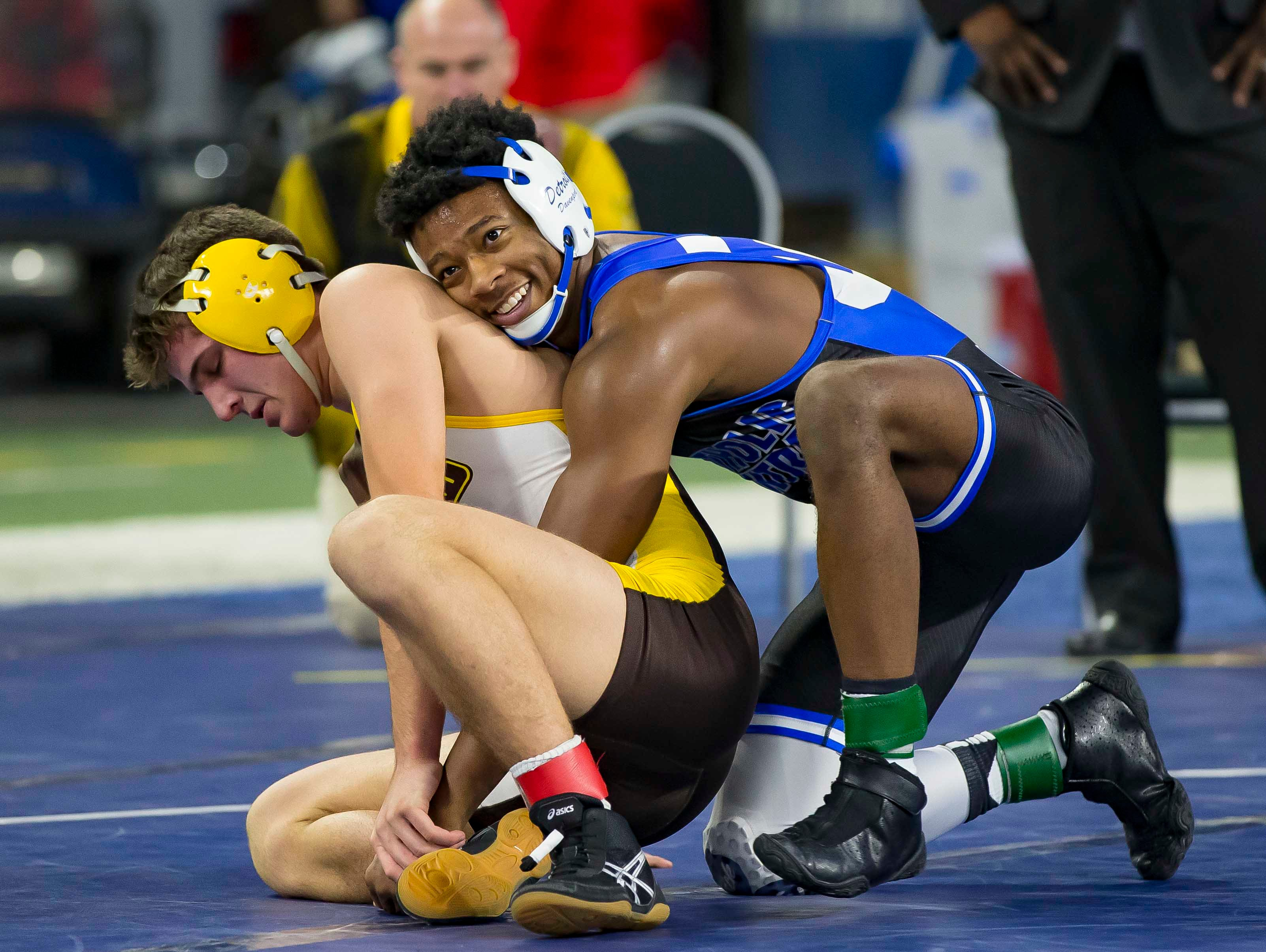 Kevon Davenport of Detroit Catholic Central, top, defeated Vic Schoenherr of Bay City Western during their 145-pound Division 1 championship match. This was Davenports 4th straight state championship.