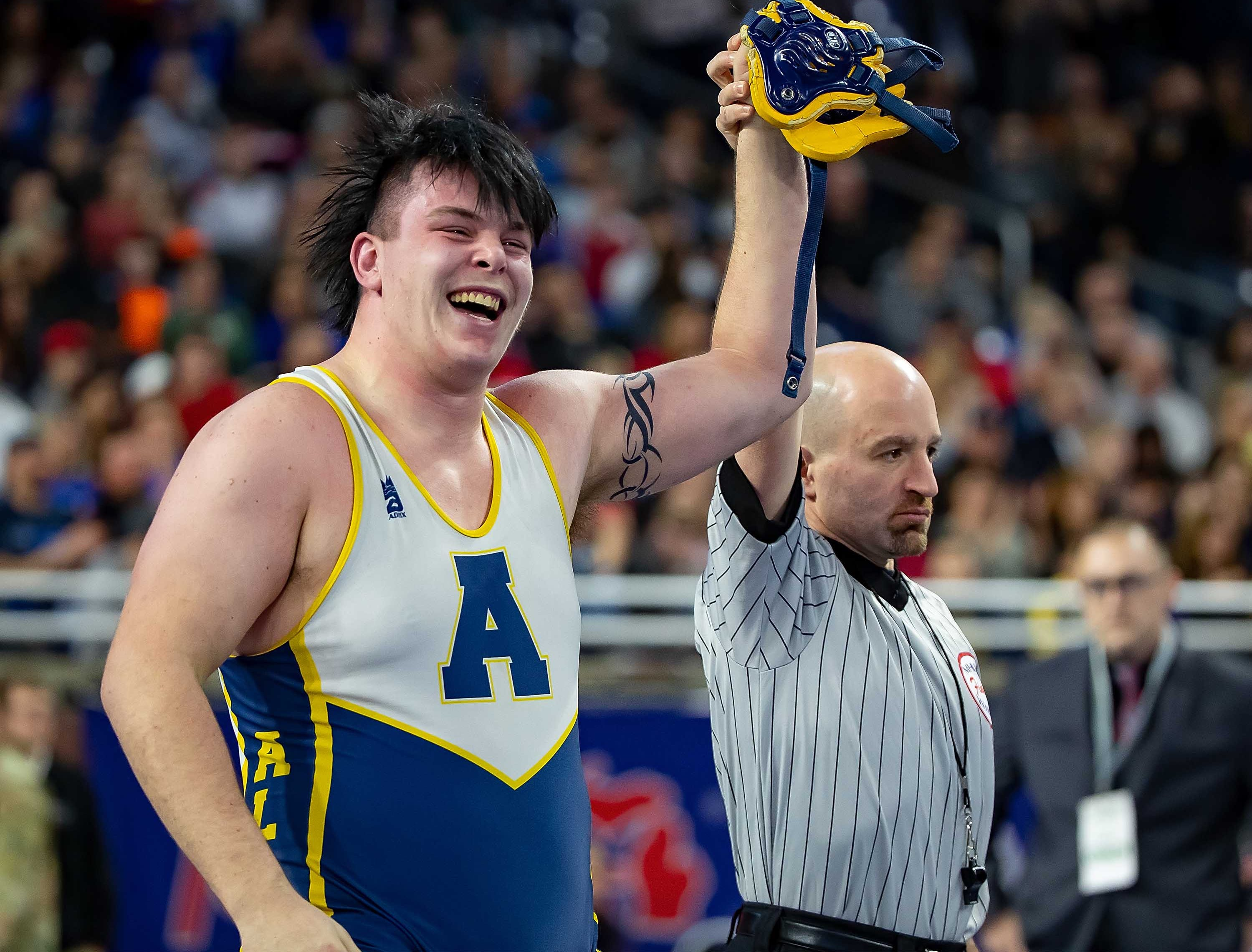 Mike Nykoriak of Algonac raises his arm in victory after defeating Brock Kuhn of Michigan Center during their 285-pound Division 3 championship match.