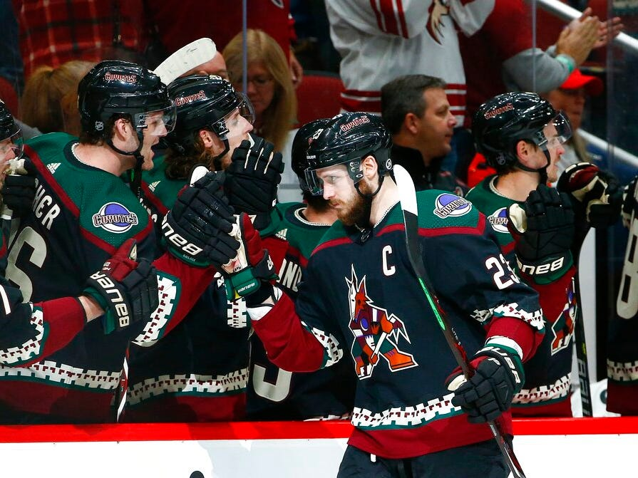 Arizona Coyotes defenseman Oliver Ekman-Larsson (23) celebrates his goal against the Detroit Red Wings with teammates on the bench during the first period.