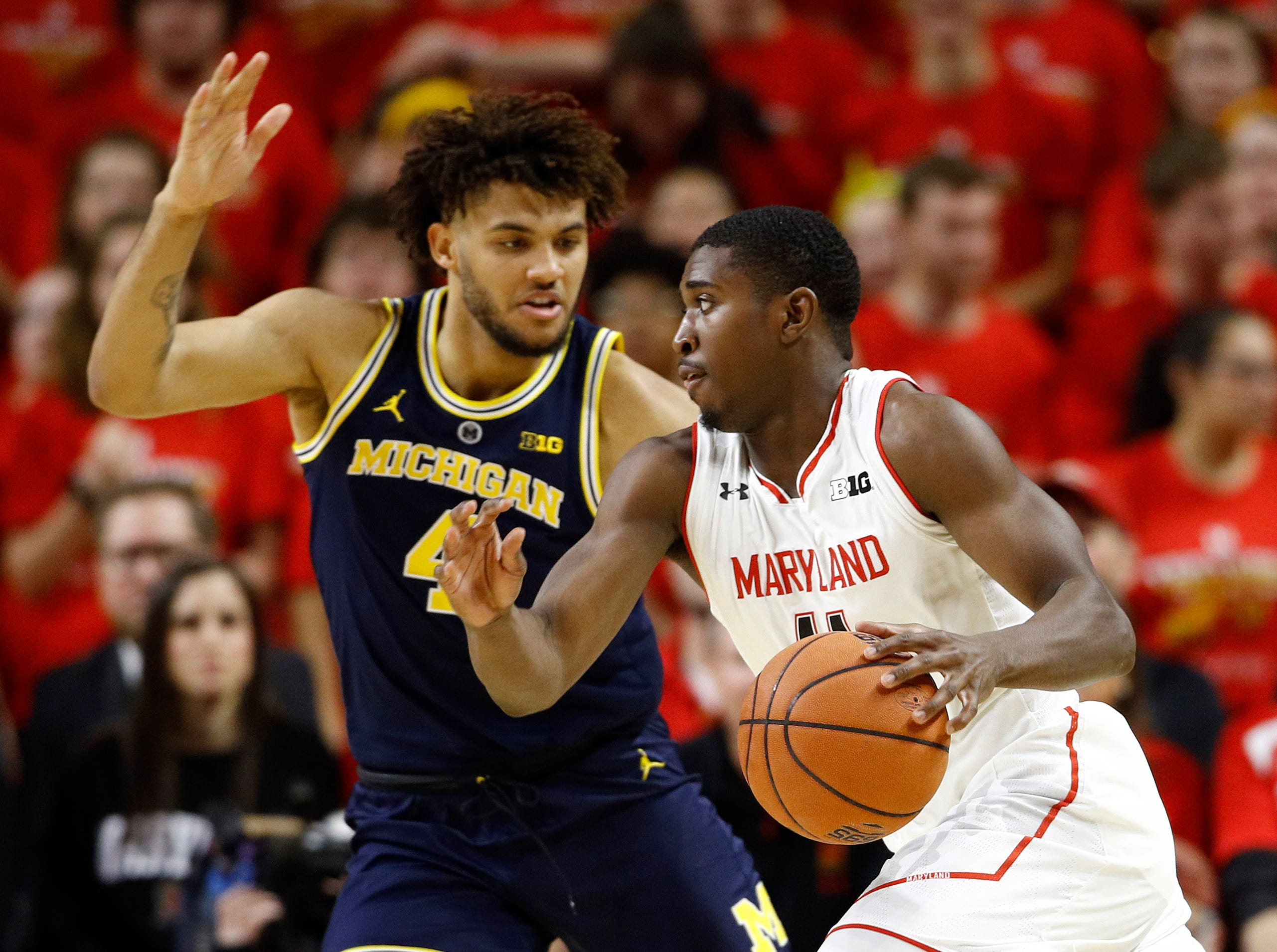Maryland guard Darryl Morsell, right, drives against Michigan forward Isaiah Livers in the first half.