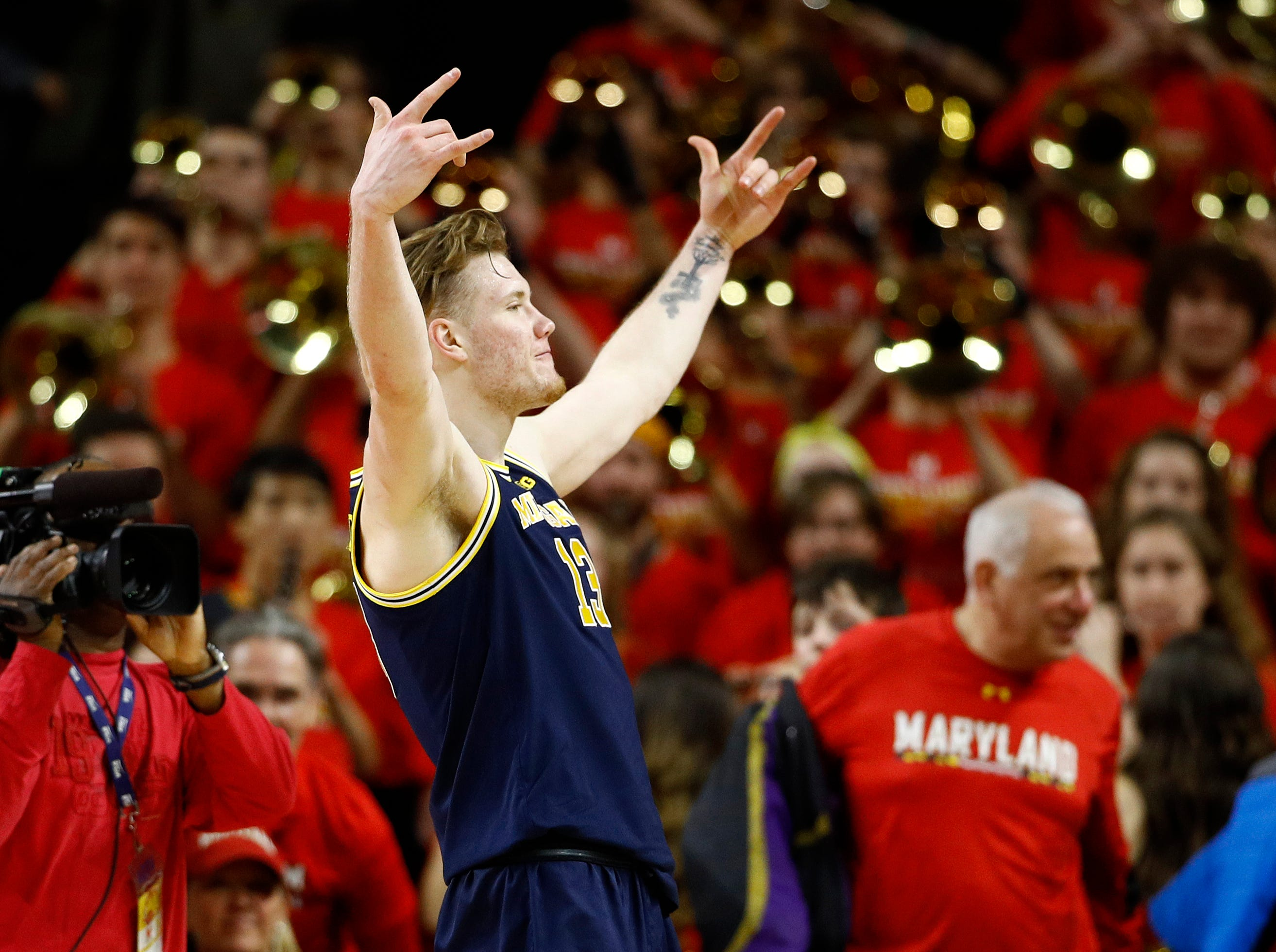 Michigan forward Ignas Brazdeikis, of Canada, gestures toward spectators in the final moments of an NCAA college basketball game against Maryland, Sunday, March 3, 2019, in College Park, Md. Brazdeikis contributed a game-high 21 points to Michigan's 69-62 win.