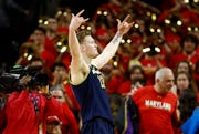 Michigan forward Ignas Brazdeikis gestures toward spectators in the final moments Sunday.