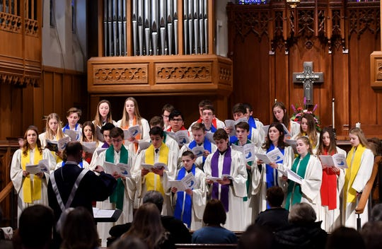 """The IXOYC and Genesis Choir sing """"Roll Down Justice"""" at the 11 a.m service at Birmingham First United Methodist Church in Birmingham on Mar. 3, 2019.   The young people on their own decided to wear rainbow-colored sashes instead of their traditional ones, to show support of the LGBT community."""