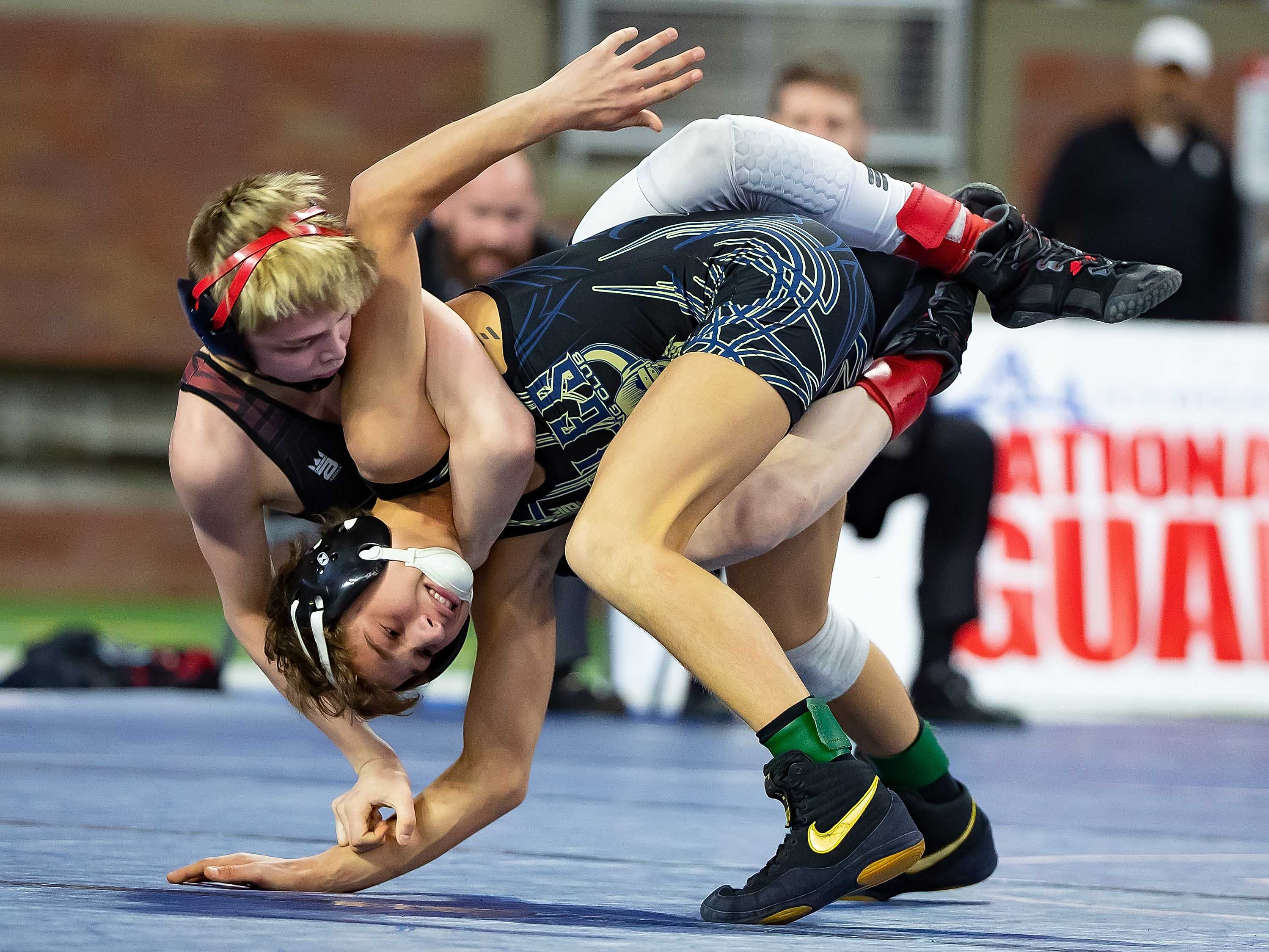 Jacob Brya of St. Johns, top, wrestles with Jamison Zimmerman of Niles during their 103-pound Division 2 championship match.