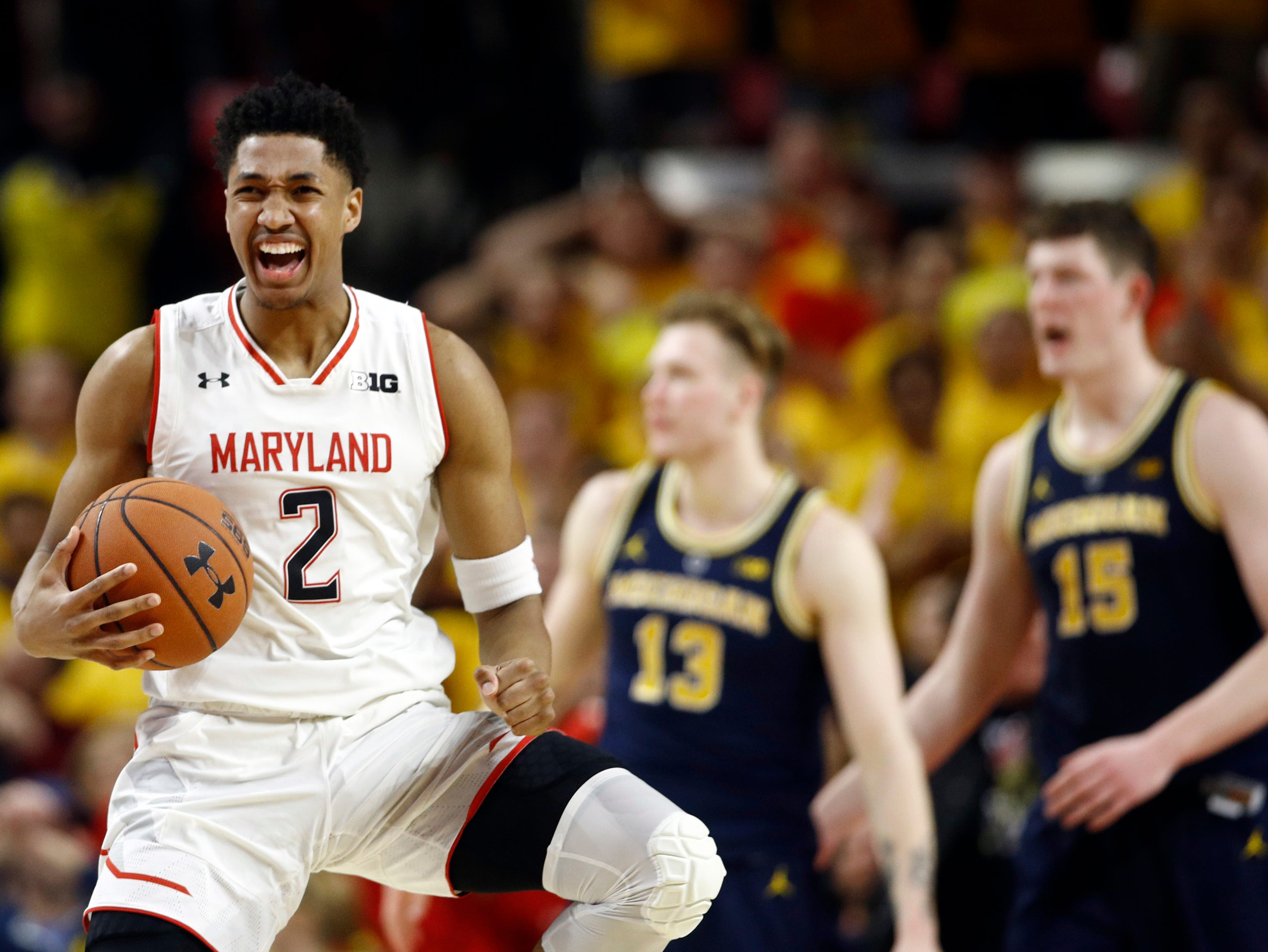 Maryland guard Aaron Wiggins, left, reacts after fouling Michigan forward Ignas Brazdeikis, of Canada, (13) in the second half.