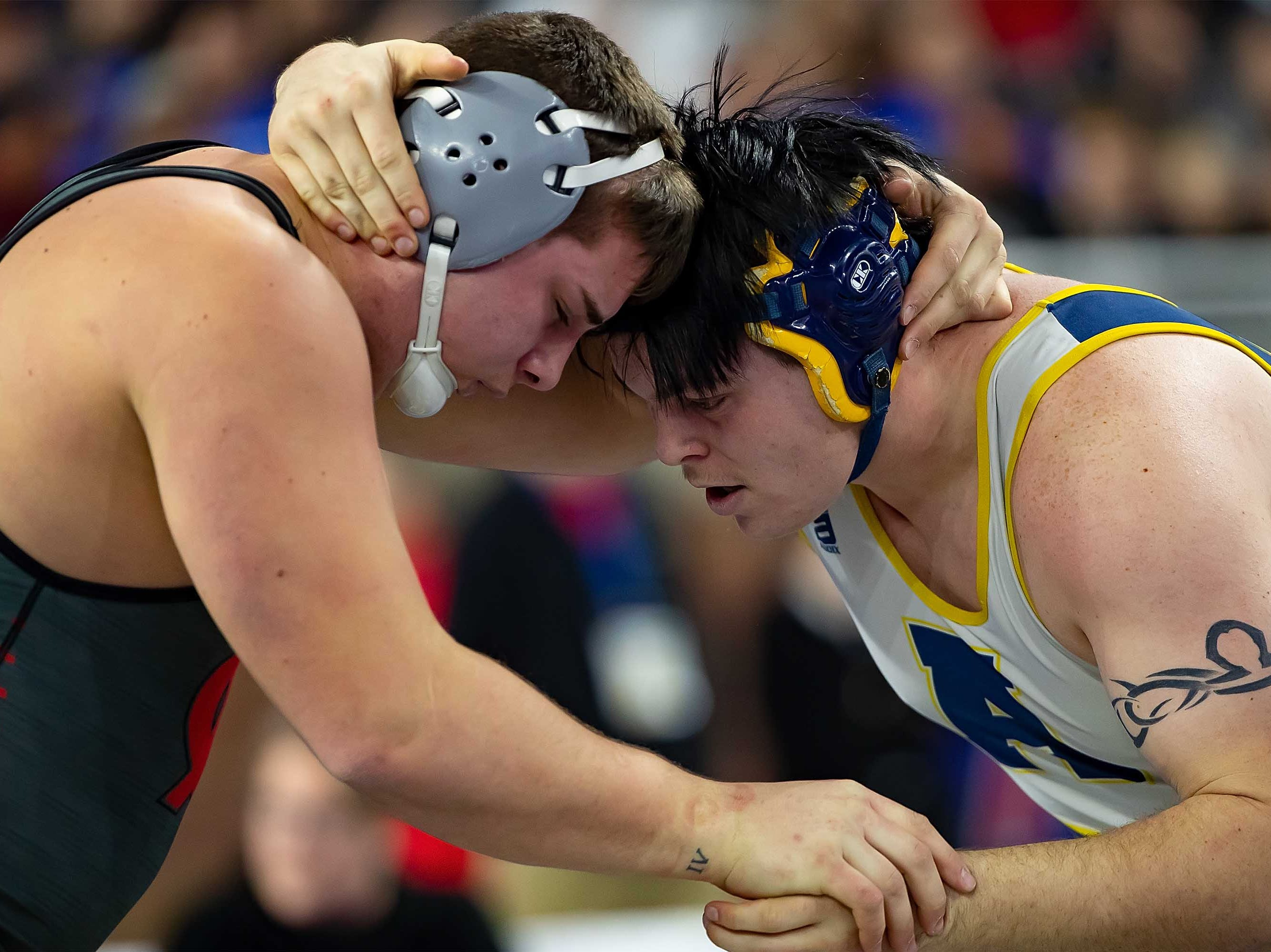 Mike Nykoriak of Algonac, right, battles with Brock Kuhn of Michigan Center during their 285-pound Division 3 championship match.
