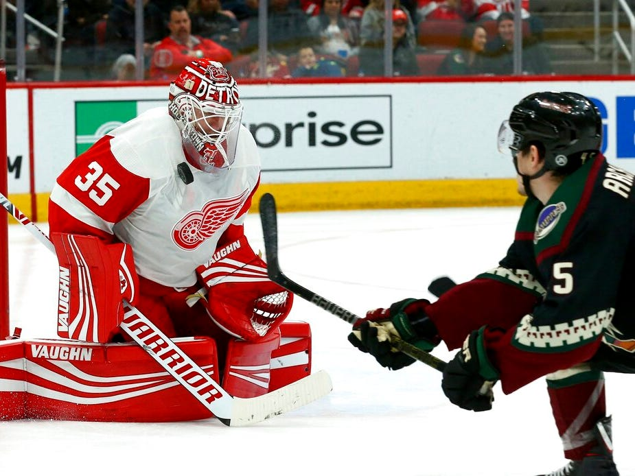 Detroit Red Wings goaltender Jimmy Howard (35) makes a save on a shot by Arizona Coyotes right wing Josh Archibald, right, during the second period.