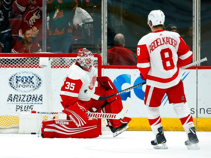 Detroit Red Wings goaltender Jimmy Howard (35) gives up a goal to Arizona Coyotes' Josh Archibald as Red Wings left wing Justin Abdelkader (8) looks on during the first period.
