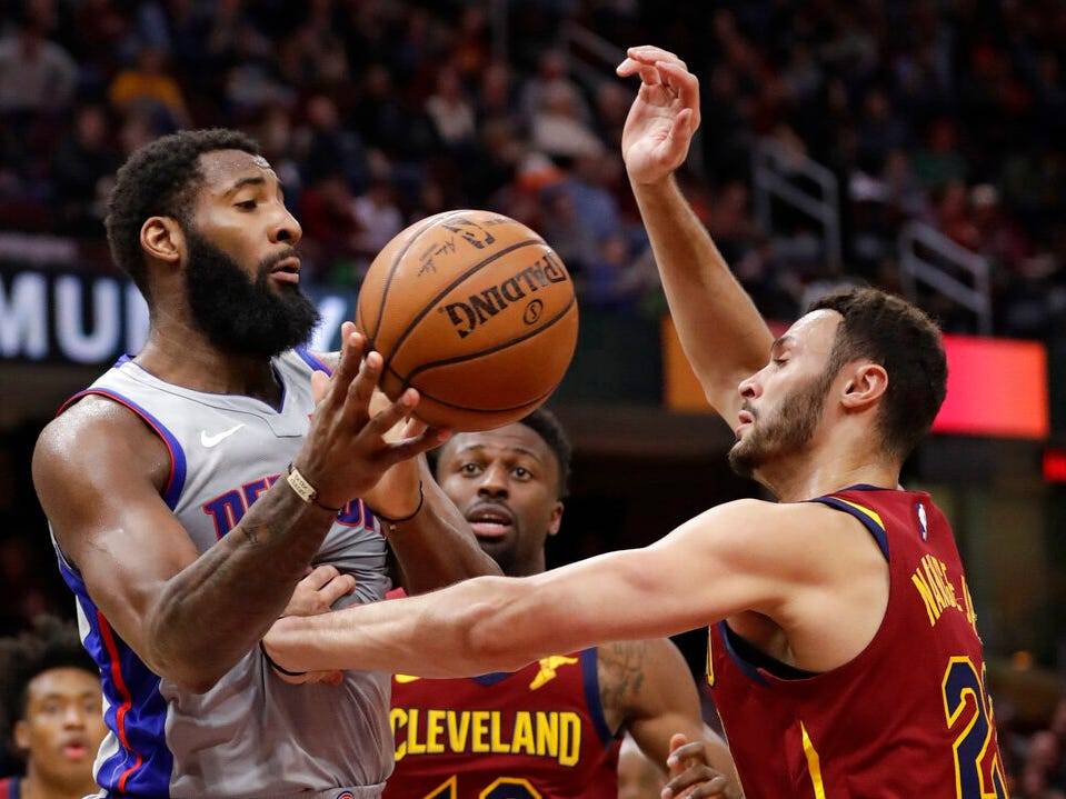 Detroit Pistons' Andre Drummond, left, passes against Cleveland Cavaliers' Larry Nance Jr. in the first half.