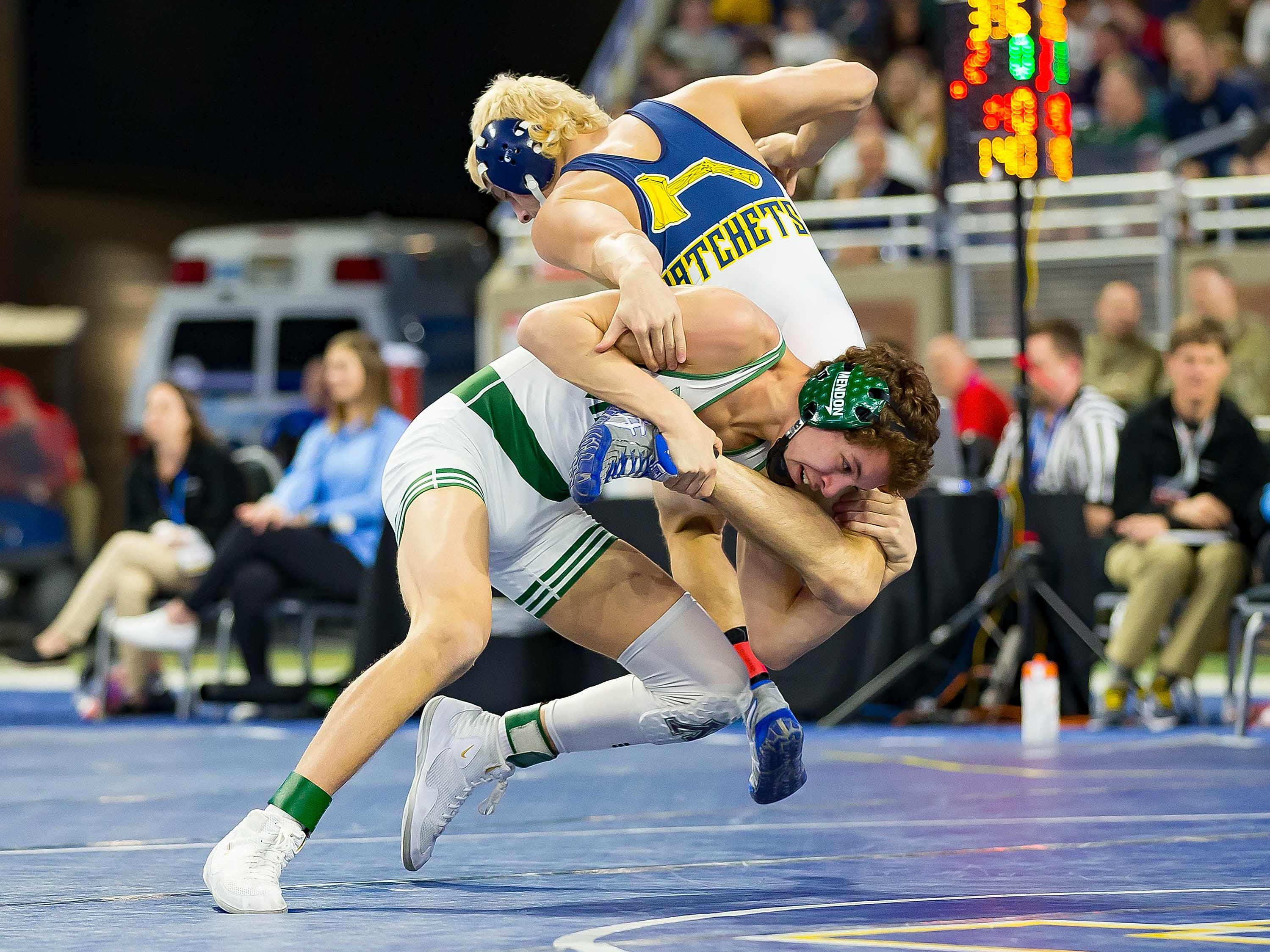 Skyler Crespo, left, of Mendon wrestles with Ryan Wehner of Bad Axe during their 140-pound Division 4 championship match.
