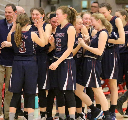 Watkins Glen players celebrate their 53-42 win over Unatego in the Section 4 Class C girls basketball final March 2, 2019 at SUNY Cortland. At the far left, Hannah Morse (3) gives Taylor Kelly a high five.