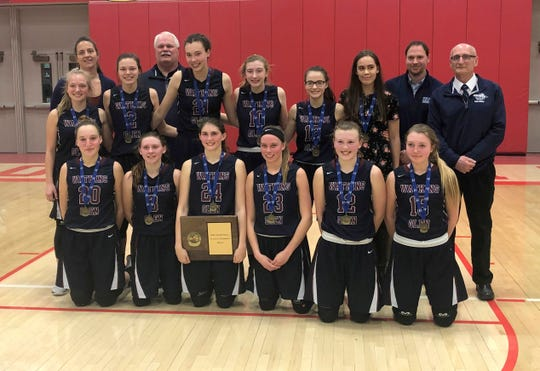Watkins Glen poses with its championship plaque after beating Unatego in the Section 4 Class C final March 2, 2019 at SUNY Cortland.
