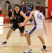Andrew Jackson of Unadilla Valley dribbles as Luke Winslow of Lansing defends during the Section 4 Class C boys basketball final March 2, 2019 at SUNY Cortland.