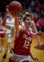 Tell City's Trent Arnold (12) drives in for a layup as the Mater Dei Wildcats play the Tell City Marksmen in the Class 2A Sectional Championship at Huntingburg's Memorial Gym Saturday, March 2, 2019.