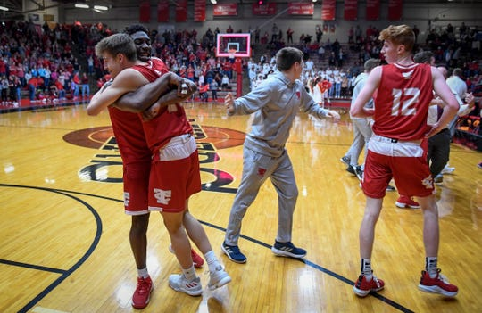 Tell City's Spencer Fest (20) and Tell City's Ty Smith (4) hug as the buzzer sounds as the Mater Dei Wildcats play the Tell City Marksmen in the Class 2A Sectional Championship at Huntingburg's Memorial Gym Saturday, March 2, 2019.
