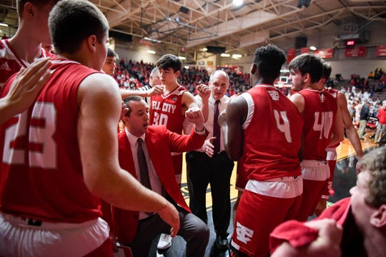 Tell City head coach Matt Lynch breaks a time-out huddle as the Mater Dei Wildcats play the Tell City Marksmen in the Class 2A Sectional Championship at Huntingburg's Memorial Gym Saturday, March 2, 2019.