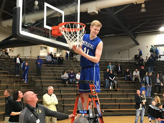 Sam DeVault cuts down the net as Memorial wins its first sectional title since 2015.